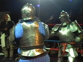 Stock Video Footage of Knights Fight in Boxing Ring with Armor and Swords