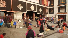 Pilgrams praying at Jokhang Palace 4 Stock Footage