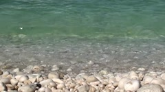 Beat of waves agains pebbles Stock Footage
