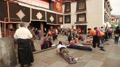 Pilgrams praying at Jokhang Palace 5 - stock footage