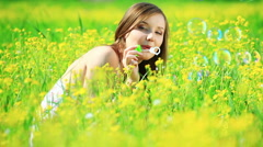 Beautiful Lady in a yellow field with bubbles. Stock Footage