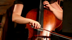 Stock Video Footage of close-up view on violoncello in orchestra