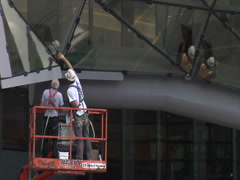 Construction Workers On Hoist Using Safety Equipment Stock Footage