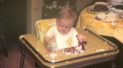 CUTE Baby HIGHCHAIR EATS Messy Plays with Birthday Cake Vintage Film Home Movie Stock Footage