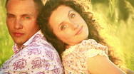 Beautiful couple in love sitting back to back. Stock Footage