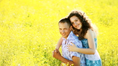 Love couple in the meadow. Look at camera-sv Stock Footage