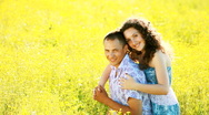Stock Video Footage of Love couple in the meadow. Look at camera-sv
