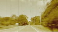 Retro look, POV driving on a country road, film effect Stock Footage