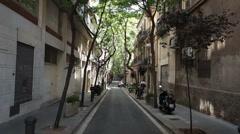 Barcelona Spain tree lined narrow road P HD 093 Stock Footage