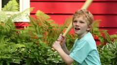 Boy playing baseball in the backyard, close up - stock footage