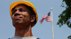 Proud worker in front of American flag - stock footage