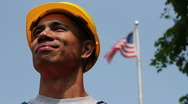 Proud worker in front of American flag Stock Footage