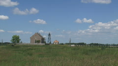 Schokland lighthouse in Dutch polder + pan seawall in reclaimed land Stock Footage