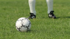 Close up of soccer ball being kicked - stock footage