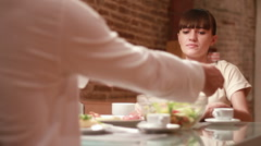Couple eats meal together, focus on woman - stock footage
