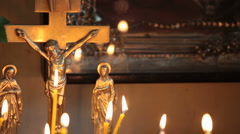 Crucifix and burning candles - stock footage