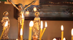Crucifix and burning candles Stock Footage