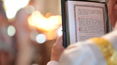 Priest reading Bible Stock Footage