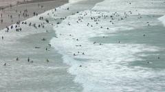 Surfers on Porthmeor beach St Ives Cornwall England Stock Footage