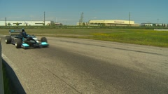 Motorsports, open wheel and SR cars race, #18 through turn Stock Footage