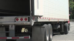 semi truck backs into loading dock - stock footage