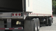 Semi truck backs into loading dock Stock Footage