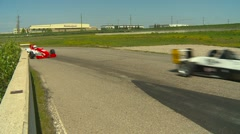 Motorsports, open wheel and SR cars race through turn, #2 Stock Footage