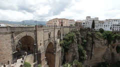 Bridge to hotel valley Ronda Spain pan P HD 9937 Stock Footage