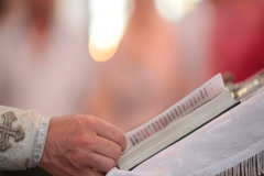 priest reading Bible - stock footage