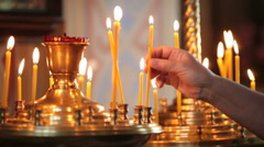 Hand with candle in  church Stock Footage