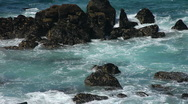 Stock Video Footage of Waves crash onto rocks at St Ives Cornwall