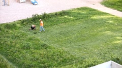 Man mows the grass on the lawn, timelapse Stock Footage