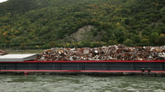 Transporting recycle dump with a ship on Rhine river 1 Stock Footage