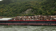Stock Video Footage of Transporting recycle dump with a ship on Rhine river 1
