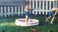 Children Backyard in Kiddie Pool Circa 1950s (Vintage Film 8mm Home Movie) HD Footage