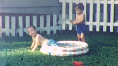 Kids CHILDREN PLAY Spash Water Kiddie Pool 1950s Vintage Film Retro Home Movie - stock footage