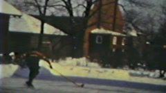 1930's - backyard hockey game - Niagara Falls, Ontario - stock footage