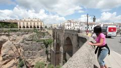 Stock Video Footage of Pretty French woman on bridge Ronda Spain P HD 9901