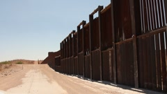 Riding close beside the border fence Stock Footage