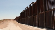Stock Video Footage of Riding close beside the border fence