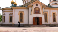 Priest coming out of a church Stock Footage