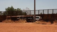 Border patrol vehicles beside the border fence Stock Footage