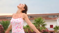 Woman in tank top enjoying of nature turns here and there Stock Footage