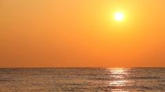 Sunset against orange sky over quiet sea waves Stock Footage