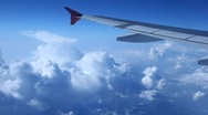 Stock Video Footage of Wing of plane close up against the blue sky