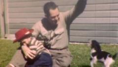 FATHER HOLDS SON Plays Puppy Doggie 1950s Vintage Old Film Retro 8mm Home Movie Stock Footage