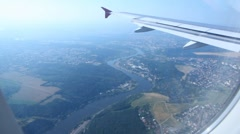 View from window on wing of plane flying over Prague and river Vltava Stock Footage