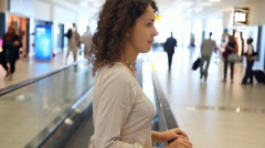 Woman moving on speedwalk at airport Stock Footage