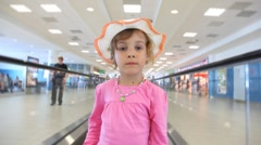 Girl moving on speedwalk at airport Stock Footage