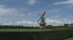 Dutch windmill in rural landscape - gristmill Stock Footage